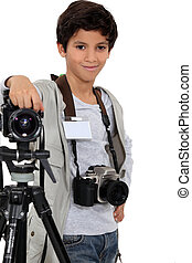 little boy acting like a professional photographer