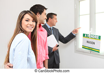 Excited young couple viewing a property