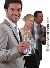 Group of people drinking champagne