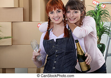 Two women celebrating house move
