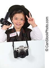 little girl dressed as a adventure reporter
