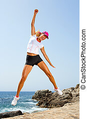 Attractive woman with winning attitude jumping. - Attractive...