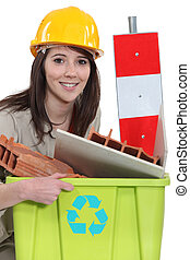 A female construction worker recycling scraps