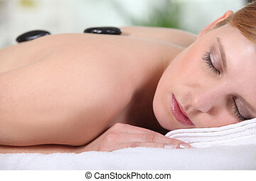 woman having a massage in a spa center