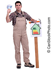 Construction worker holding an energy efficiency rating...