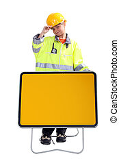 little boy in a costume of roadworks employee behind a...