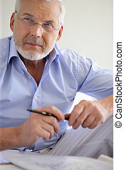 Pensive gray-haired man