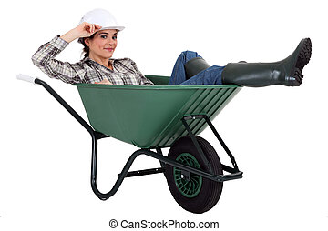 Woman in a wheelbarrow