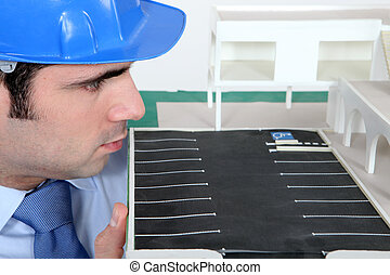 architect examining a scale model