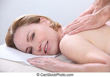 Woman enjoying a back massage