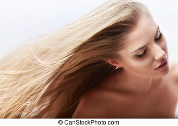 Healthy hair - Young attractive girl with flying hair