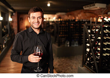 Sommelier - Smiling man in the wine cellar