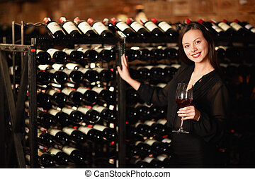 Sommelier - Attractive woman in the wine cellar