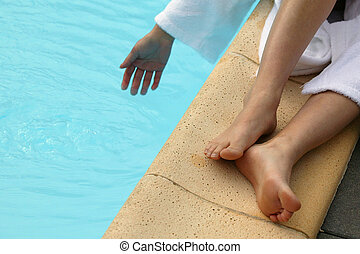 Man with his hand in a pool