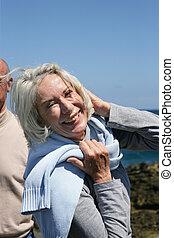 Happy senior couple at the coast