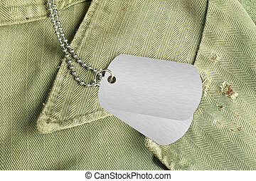 Dog tags on uniform - Blank dog tags on an old military...