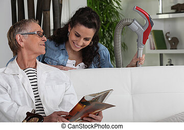 Cleaning lady with senior woman