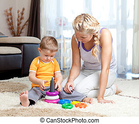 cute mother and kid boy playing tog