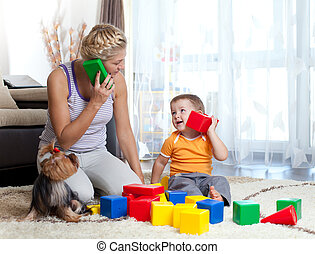mother and kid boy role-playing together indoor - mother and...
