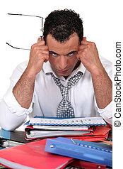 Frustrated businessman with files