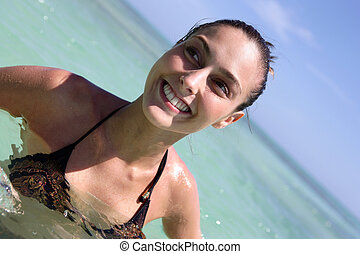 Smiling woman in the sea
