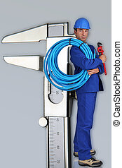 Photo-montage of small plumber next to giant calliper
