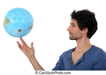 Man with a globe spinning