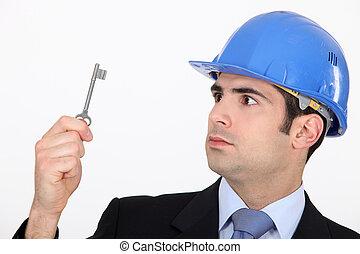Man staring at a key