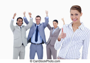 Close-up of a woman smiling and approving with enthusiastic...