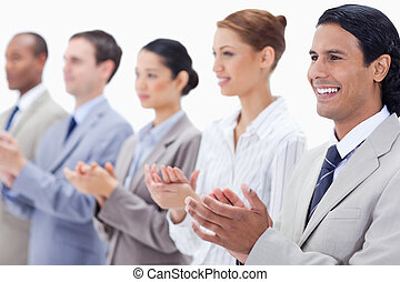 Close-up of a business team applauding - Business team...
