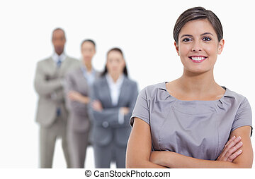 Close-up of a business team crossing their arms and standing...