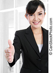 business woman offering handshake - Beautiful business woman...