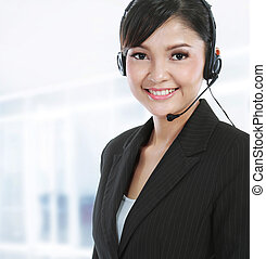 customer service operator with headset - Young beautiful...