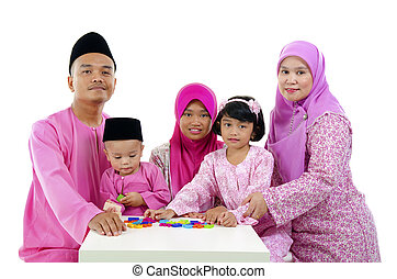malay family during hari raya aidilfitri having fun with...