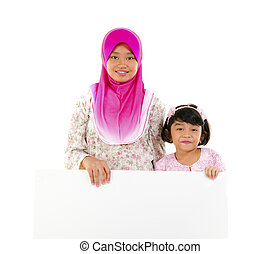 malay sisters with board - malay sisters with copyspace...