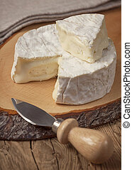 Camembert - Creamy soft camembert cheese on wooden board