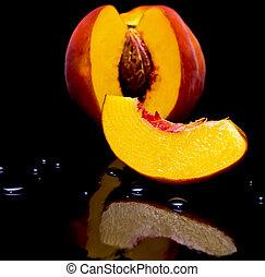 Peaches shot against black
