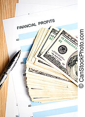 financial profits - dollars with document showing financial...