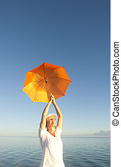 Relaxed Senior woman at ocean background - Attractive...