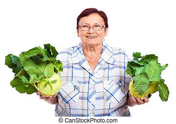 Happy senior woman with kohlrabi - Happy smiling senior...