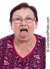 Senior woman sticking out tongue - Funny senior woman...