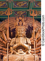 kuan yin wood sculpture - guan yin wood sculpture is a...