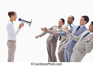 Woman yelling at people dressed in suits through a megaphone...