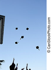 Grad students throwing their hats in the sky - Low...