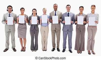 Business people smiling while holding support for letters -...