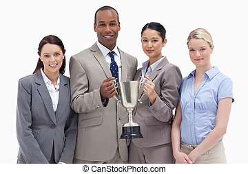 Close-up of a business team holding a cup against white...