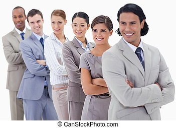 Big close-up of a business team in a single line looking towards the left side with focus on the first woman