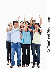 People smiling together and approving with the thumbs-up