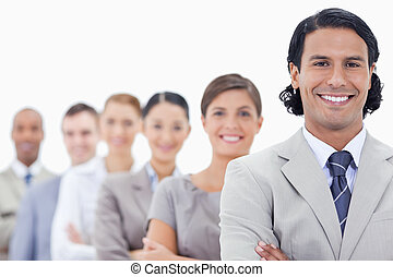 Big close-up of a happy business team crossing their arms in...
