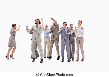 Very happy business people jumping and clenching their fists...